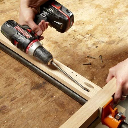 <b>Photo 8: Assemble the face frame</b></br> Clamp the face frame together and drive in pocket screws. Pocket screws rarely strip out in hardwood, so you can skip the screwdriver and use only a drill.