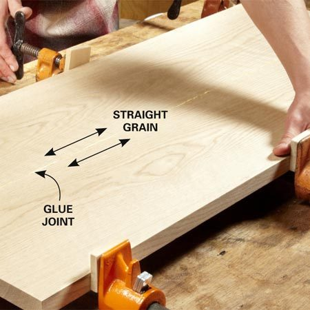 <b>Photo 11: Glue up the top</b></br> <p>Edge-glue the boards together  to form the top.   Choose boards that have  straight grain lines along one   edge and place those edges  together. A glue joint with   straight  grain on both sides is almost invisible. </p>