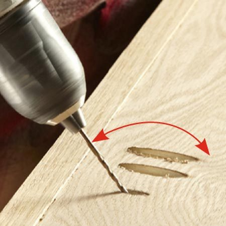 <b>Photo 12: Drill slotted screw holes</b></br> Drill screw holes in the shelf box to fasten the bookcase top. Rock the bit back and forth to bore enlongated slots that will allow the top to swell with changes in humidity.