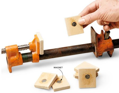 <b>Easy-stick clamp pads</b></br> Magnets mounted in small wood blocks hold the pads on the steel clamp jaws.