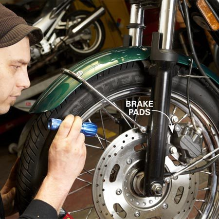 <b>Brake job: $125</b></br> Shine a flashlight through the spokes to light up the inboard brake pad. If the pad is worn to within 1/8 in. of the steel backing plate, it's time to replace the set.