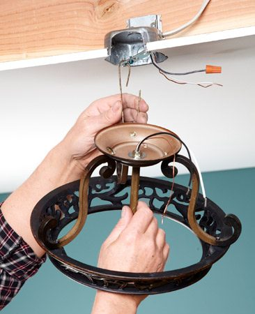 <b>Improvise an extra hand</b></br> Bend a scrap of wire to support the fixture while you wire it.