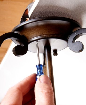 <b>Aligning a screw hole</b></br> Align the screw hole with a thin screwdriver.