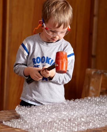 <b>Learning to hammer</b></br> <p>To a kid who's not   quite ready to drive   nails, nothing feels   better than whap,   crackle and pop.   Supply a kid-size   hammer or a rubber   mallet. (Hearing   protection is a good   idea here. This gets   LOUD.) </p>
