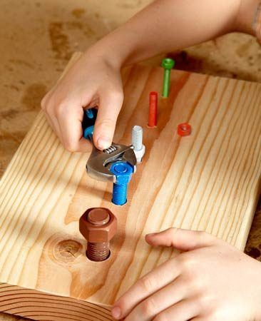 <b>Using a wrench</b></br> <p>Wrenches are great for beginning   tool users. We sink different-size   bolts into boards and then let children   use wrenches to attach color-coordinated   nuts.</p> <p>Timothy Dahl</p>