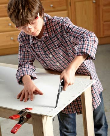 <b>Sawing practice</b></br> <p>Clamp some foam core to a  workbench   and let kids saw it into  strips.   Foam core is easier to saw  through   than wood, and a keyhole saw  is   perfect for small hands. You  can buy   foam core at craft, art and  office   supply  stores. </p>