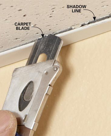 <b>Scribe panel edges </b></br> Carve shadow lines along cut panel edges by scoring them in place. Learn <a href='http://www.familyhandyman.com/ceiling/how-to-cut-ceiling-tiles' title='How to Cut Ceiling Tiles'>how to cut ceiling tiles</a> in our video tutorial.