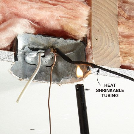 <b>Photo 3: Shrink the tubing</b></br> Wave the flame from a lighter under the heat shrinkable tubing. Keep the flame moving so the heat does all the work and the tubing doesn't burn.