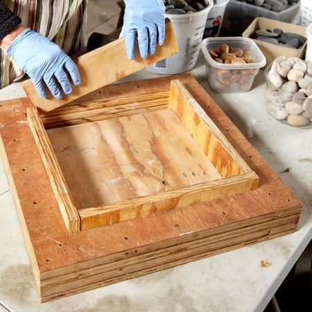 <b>Photo 1: Assemble the mold</b></br> This plywood mold goes together quickly and comes apart easily after the mortar hardens. And you can use it again and again.