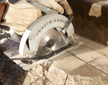 <b>Photo 2: Slice up the damaged area</b></br> Cut the stair tread into a 4- to 5-in. grid pattern. Sawing concrete is no fun, but the more cuts you make, the easier it will be to break off the step's surface.