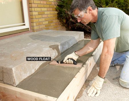 <b>Photo 6: Finish the concrete</b></br> Skim the surface with a wood float. When the mix hardens a little, round the edges with a concrete edger and smooth it with a steel trowel. Don't overwork the concrete or you'll weaken the surface.