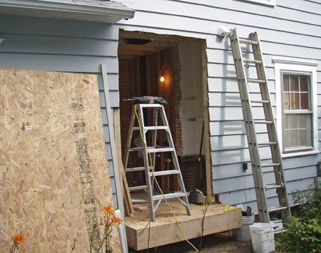 <b>Install a shoring wall</b></br> Install a temporary shoring wall to hold things up while you cut the hole, extend the floor and set the header.