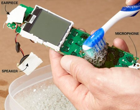 <b>Photo 1: Scrub off the crud</b></br> Dip the toothbrush into the cleaning solution and gently scrub the soda residue from the push buttons and the circuit board.