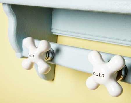 <b>Faucet handle hooks</b></br> Drill holes through a backer and attach the handles with their mounting nuts.