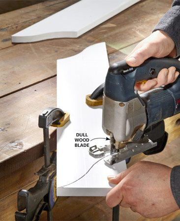 <b>Photo 1: Cut the side curves</b></br> A dull blade actually works better than a sharp blade, which tends to grab and shake the PVC as it cuts. Cut one side of the news paper box, then use it as a template to mark the other side.