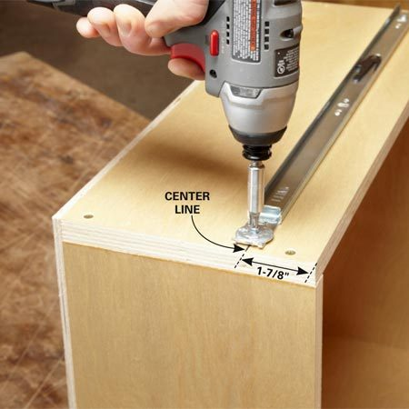 <b>Photo 9: Mount the drawer slides</b></br> Draw a line parallel to the top of the drawer to indicate the center of the drawer slide. Line up the slide by centering the line in screw holes. Attach the slide with the screws provided.