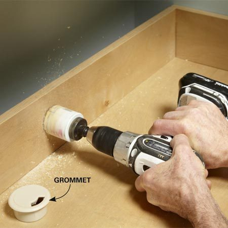 <b>Photo 12: Hide cords behind a tall backsplash</b></br> Attach the backsplash with cleats, holding it about 4 in. from the wall. Then drill holes where you'll have cords and install cord grommets.
