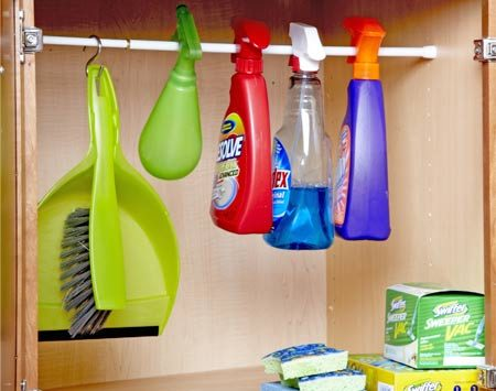 <b>Hang spray bottles</b></br> Hang spray bottles from a rod to keep them upright.