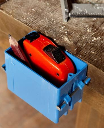 <b>Tape measure box</b></br> Plastic electrical boxes make convenient houses for tape measure storage.