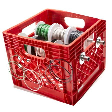 <b>Plastic create dispenser</b></br> Contain that wire snarl with an inexpensive plastic crate.