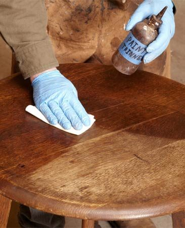 <b>Wipe on mineral spirits</b></br> Wipe on mineral spirits to highlight the condition of the old finish.