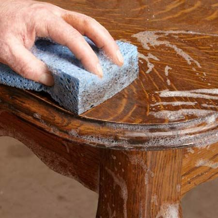<b>Wash with soap and water</b></br> Gently scrub the furniture with soap and water to remove dirt and grime. Then dry it.