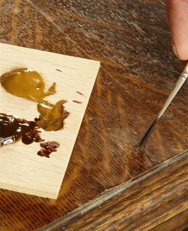 <b>Photo 5: Stain the epoxy to match</b></br> Stain the patch with gel stain to match the color and pattern of the grain. Match the stain color to the light and dark areas of the wood.