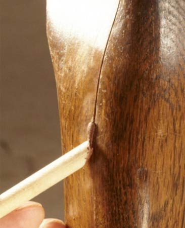 <b>Apply colored wax to cracks</b></br> Fill holes and cracks with special wax sticks. Then smooth them.