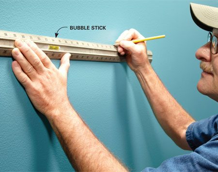 <b>Time-saving tip</b></br> <p>Tim uses a bubble stick rather  than a level. A bubble stick is like a ruler and a level rolled   into one. Holding a level  against the wall with one hand can be frustrating. Levels are   rigid, and they pivot out of  place when resting on a stud that's bowed out a bit. A bubble   stick has a little flex, so it  can ride the imperfections of the wall yet still deliver a straight   line.  You can get one at <a href='http://www.acehardware.com' rel='nofollow'>acehardware.com </a> for less than $10. </p>