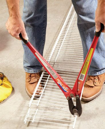 <b>Cutting advice</b></br> Cut your shelving with a bolt cutter. It's quick and easy, and it makes a clean cut. To make room for the cutter, Tim uses his feet to hold the shelving off the ground.