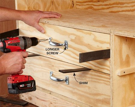 <b>Photo 4: Position drawer fronts perfectly</b></br> With the drawer box in place, position the front with shims. Fasten the pulls with 1-1/4-in. screws. Those screws will hold the front in place so you can pull the drawer out and add more screws from inside.