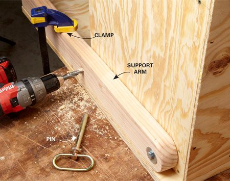 <b>Photo 6: Drill the pin hole</b></br> Make sure the folding top is clamped securely to the support arm before you drill a hole for the hitch pin. When drilling a hole this big, it's easier to start with a pilot hole about half the size.