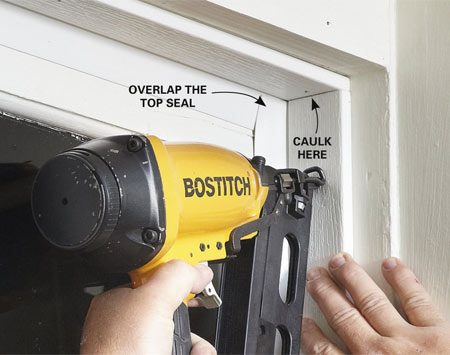 <b>Photo 7: Nail on self-sealing door stop</b></br> Slide the door stop against the garage door so the vinyl seal bends at about a 45-degree angle. Then nail the stop into place with galvanized (or aluminum) 1-1/2-in. nails.