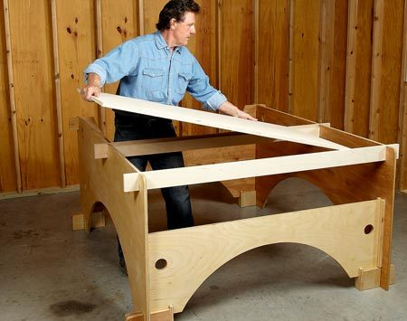 <b>Photo 4: Build the outfeed table</b></br> Assemble the frame and make sure it's square. Set the struts in place, then glue and nail the table to the struts.