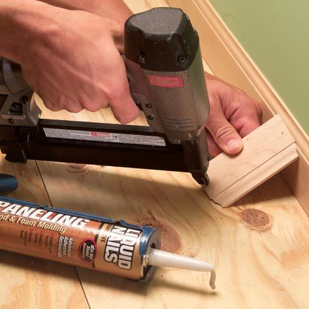 <b>Baseboard brace</b></br> Close small gaps along baseboard with adhesive and a temporary brace.