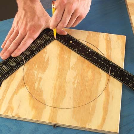 <b>Lay out a circle</b></br> Mark a circle with two nails and a framing square.