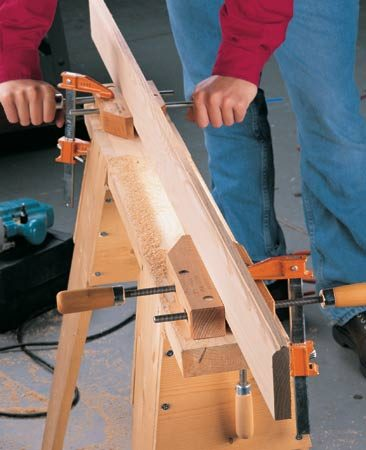 <b>Hand screw vise</b></br> Tighten a pair of hand screws on your board. Then clamp them down.