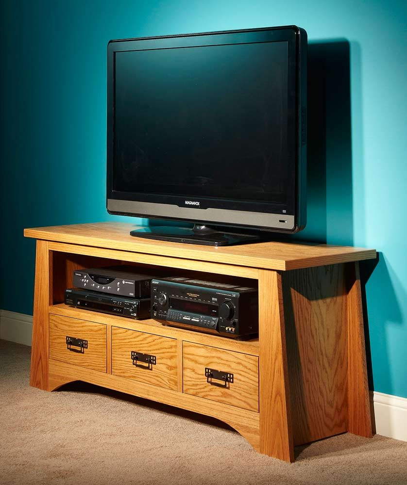 Completed DIY TV stand with a TV, DVD player and other electronics.