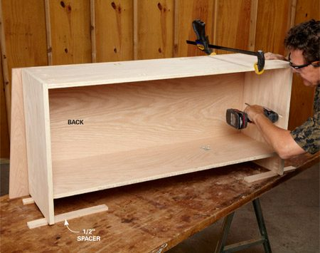 <b>Photo 6: Add the back</b><br/><p>Set the cabinet on 1/2-in. spacers and attach the back with pocket screws. Attach the face frame the same way.</p>