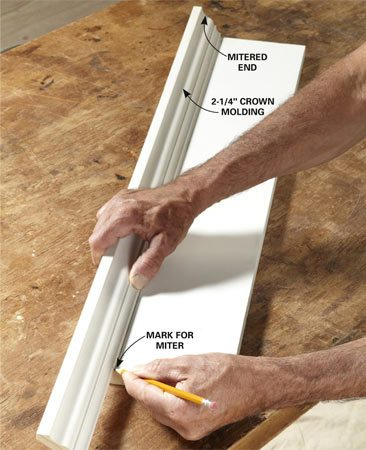<b>Photo 7: Mark the front crown molding</b></br> Cut a miter on one end of the front crown molding. Line up the cut with one end of the head casing and mark the opposite end for cutting. Set the molding in your jig and cut the opposite miter.