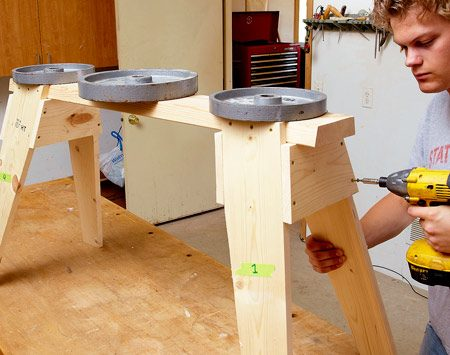 <b>Attach the gussets</b></br> Set each sawhorse upright and set something heavy on it so all the legs are sitting nice and flat. Attach the gussets with four 1-5/8-in. screws.