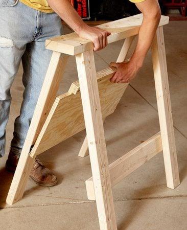 <b>Shelf locks the legs</b></br> The lip on the shelf holds the sawhorse rigid. To break down the sawhorse, simply lift the shelf.