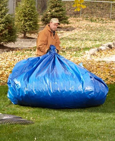 <b>Drag and drop</b></br> Instead of bagging or hauling leaves, I rake them onto a tarp, which I drag into the woods. It's even easier if you get your kids to do it!