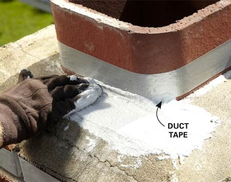 <b>Photo 1: Apply the first coat of chimney sealer by hand</b></br> Scoop up a handful of the sealer and wipe it onto the crown. Force the sealant into the cracks and into the crown-to-brick seam.