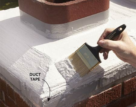 <b>Photo 2: Even out the chimney sealer</b></br> Stroke the wet sealant with a brush to level the high and low spots and create a smooth surface.