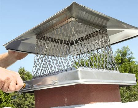 <b>Photo 4: Install the cap</b></br> Set the cap over the flue liner and secure it with screws. Tighten until snug, but no more. Excessive pressure can crack the clay liner.