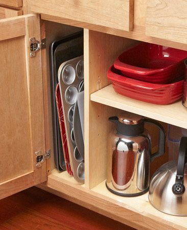 <b>Organization tip for pans and trays.</b><br/>Keep trays, baking pans and cutting boards organized and easy to find.