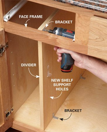 <b>Fasten the divider with brackets</b></br> Screw two brackets to the cabinet floor; one to the face frame and one to the back wall of the cabinet (not shown).