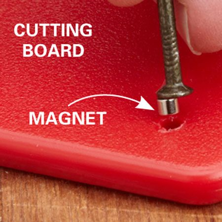 <b>Magnetize your cutting board</b></br> Drill holes sized for the magnets and drop in a dab of super glue. Insert the magnets with a nail head. Slide the nail sideways to release the magnet.