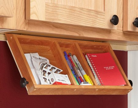 <b>Pen and paper organization tip</b><br/><p>This tray is perfect   for pens and paper.   When closed, it&rsquo;s   mostly hidden by the   cabinet face frame.   To install the tray,   screw on the hinges   first. Then open the   cabinet door above   and clamp the tray to   the underside of the   cabinet while you   screw the hinges to the cabinet.</p>